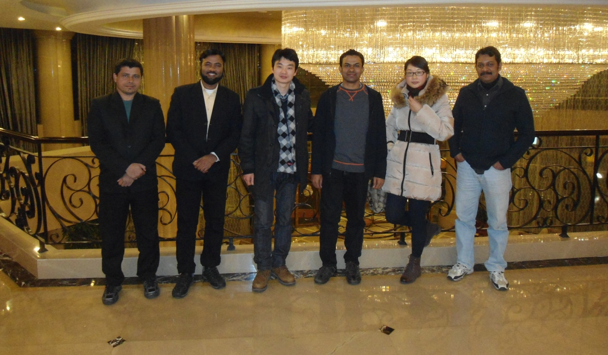 MD and ED with guests after a trination meeting in China